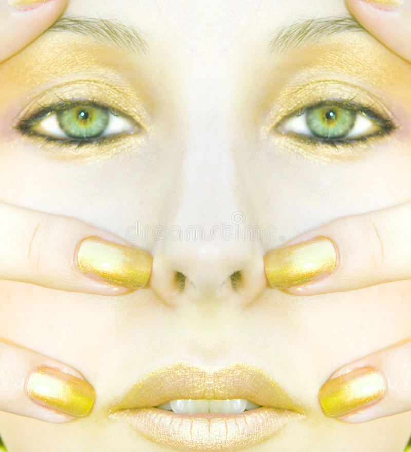 Symmetric gold face of woman stock image