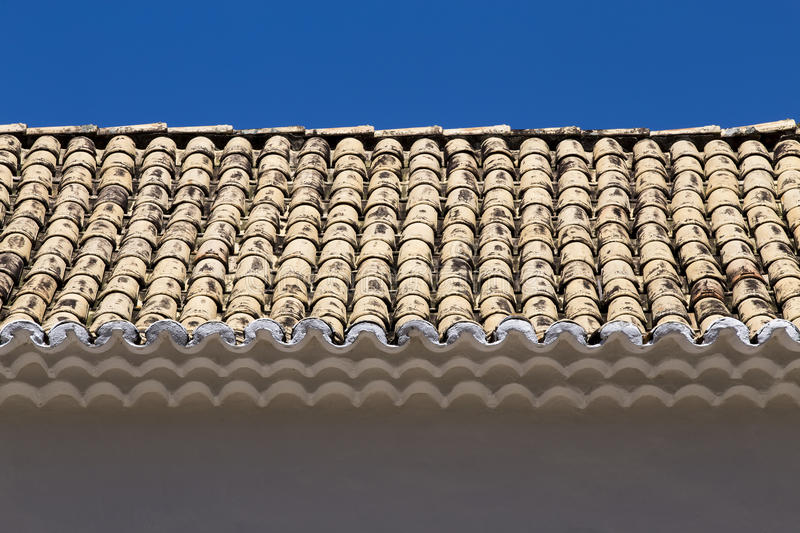 Symmetrical composition with wall and roof. PORTO SEGURO, BA, BRAZIL - MARCH 13, 2016 - Wall and roof of tiles of the the historic city of Porto Seguro, Bahia stock image