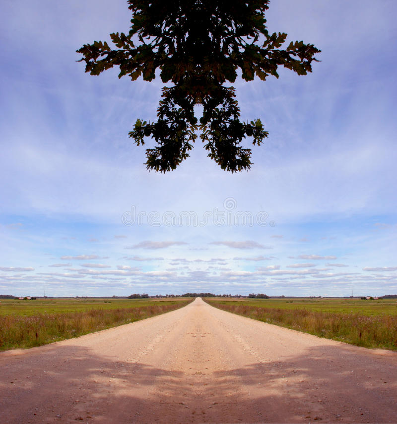 Symmetrical countryside road composition. Symmetrical countryside gravel road composition royalty free stock photography