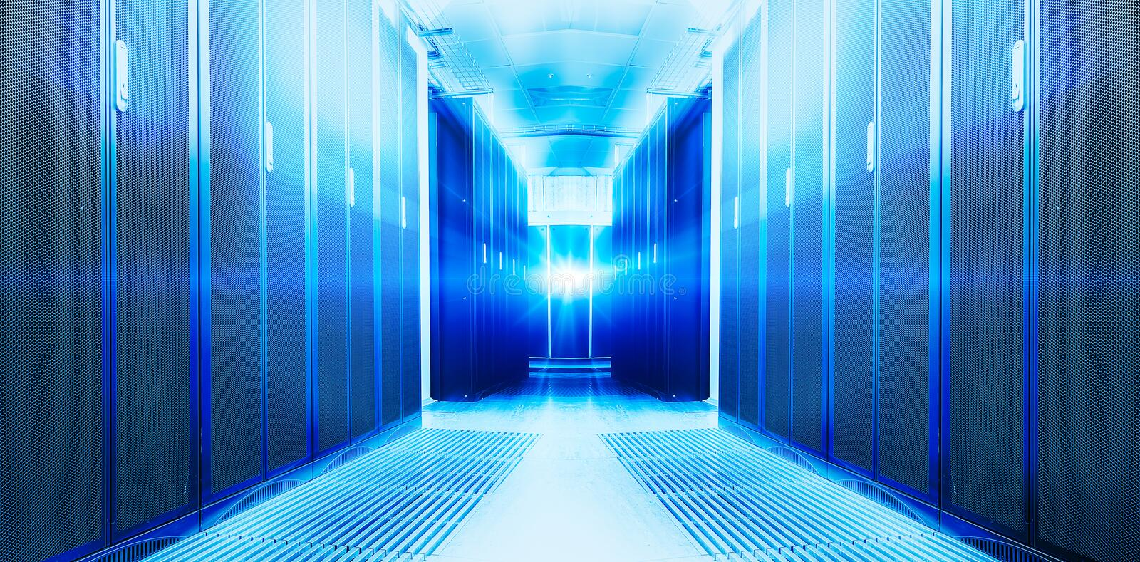 Symmetrical futuristic modern server room in the data center with a bright light royalty free stock images