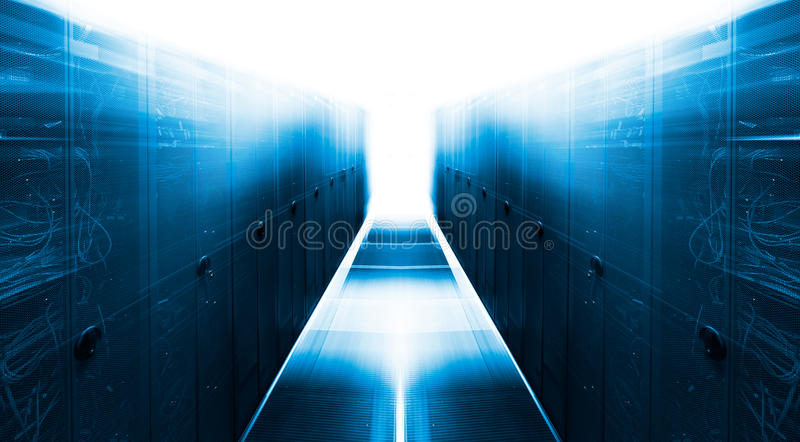 Symmetrical futuristic modern server room in the data center with bright light. Symmetrical futuristic modern server room in the data center with a bright light royalty free stock photos