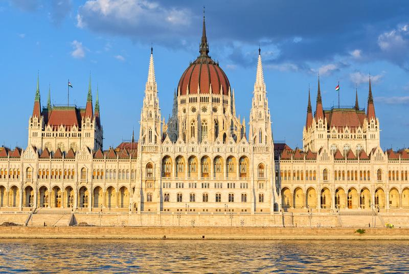 Hungarian Parliament Building - Budapest. The symmetrical main facade and the central dome of the Hungarian Parliament Building overlook the River Danube stock image