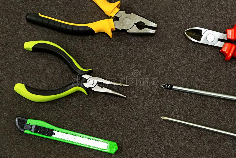 Symmetrical pattern series green nippers clerical knife screwdriver background construction network power supply repair royalty free stock photos