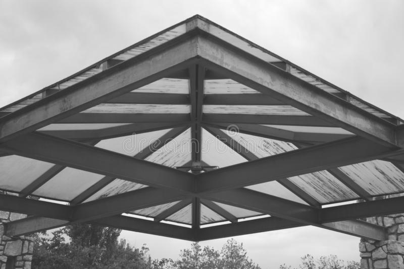 Symmetrical roof structure in black and white. Symmetrical roof structure in black and white in a park royalty free stock images