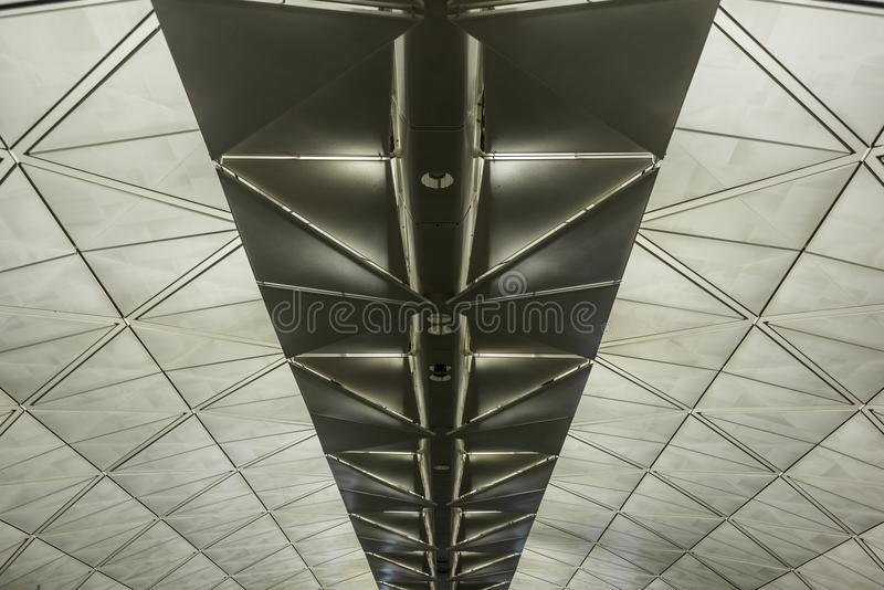 Symmetrical roof structure with triangles. In an airport royalty free stock photography