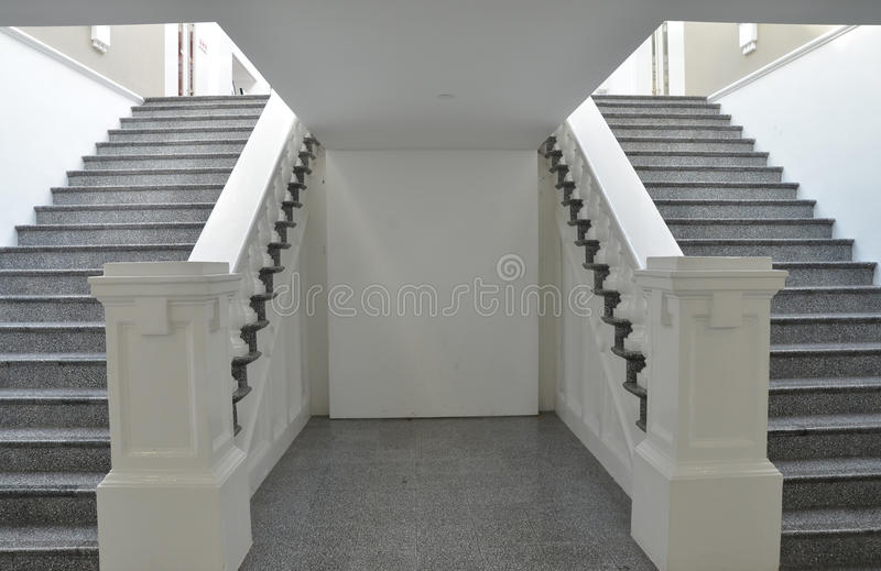 Symmetrical stairways. Symmetrical pattern of stairways found in the museum royalty free stock photos