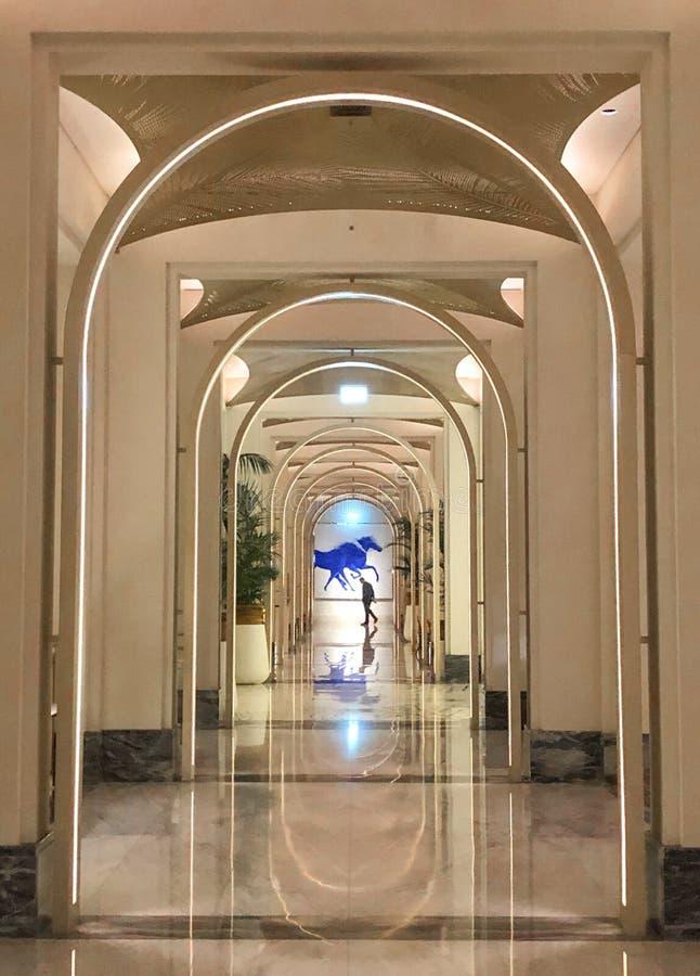 Symmetry arch reflection corridor hotel dubai madinat night porter. Marble floor expensive luxury style arabic royalty free stock photos