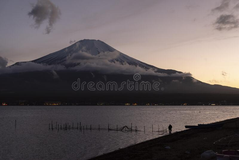 Symmetry snowcapped volcano mountain Fuji against Yamanakako famous tourist lake royalty free stock images