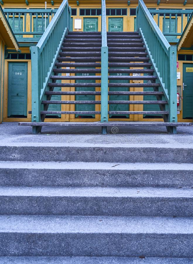 Stairs to wooden cabins in historic natural thermal pool in Bad Fischau, Austria. A symmetry of stairs to wooden cabins in historic natural thermal pool in Bad royalty free stock photo