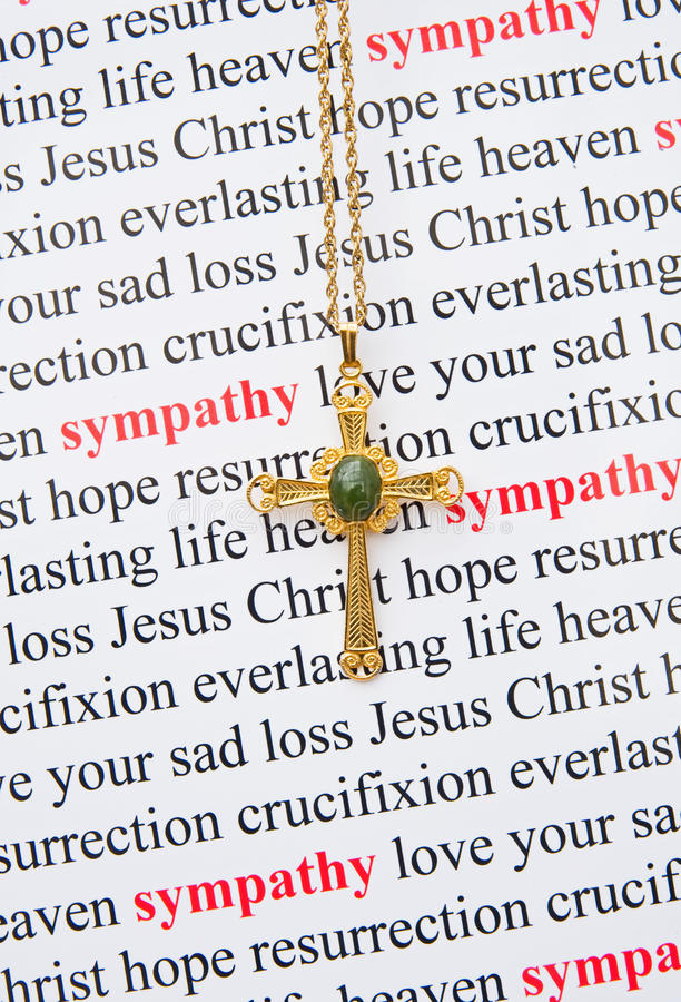 Sympathy card. An image of words relating to sympathy upon the death of a relation or dear friend with a gold Christian cross as the focus. The idea is to royalty free stock photography