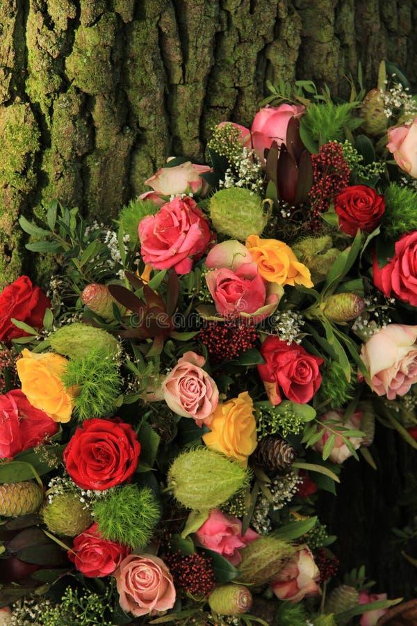 Sympathy wreath near a tree. A floral sympathy wreath near a tree royalty free stock images