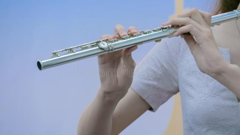 Woman playing flute stock photography