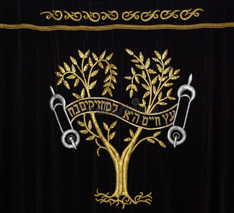 Synagogue curtain. The traditional curtains of the ark containing the Torah scrolls, depicting the Tree of Life. The Hebrew quotation states that the Torah is a royalty free stock photos