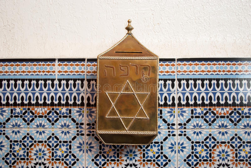 Moneybox in the synagogue of Marrakech stock photos