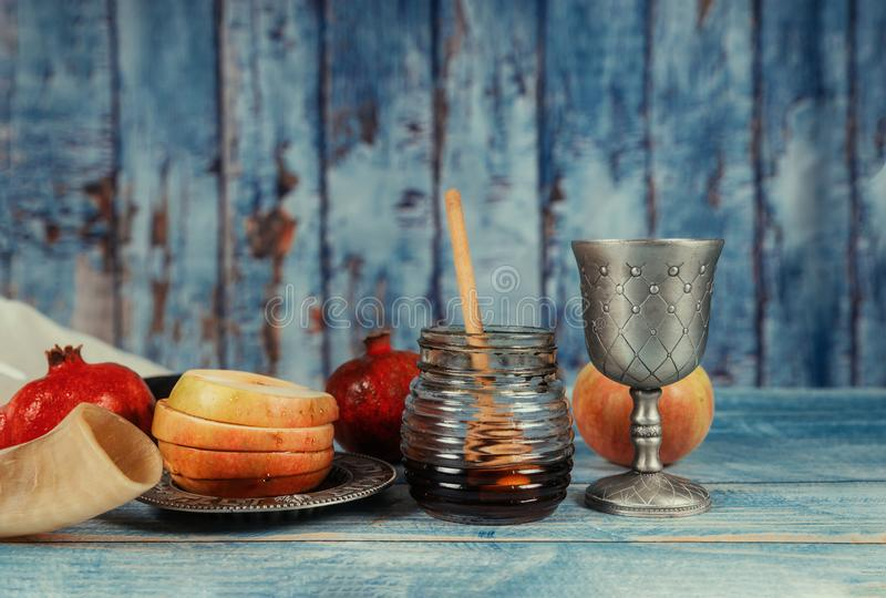 On the table in the synagogue are the symbols of Rosh Hashanah apple and pomegranate, shofar talith. Synagogue of Rosh Hashanah apple and pomegranate, shofar stock image