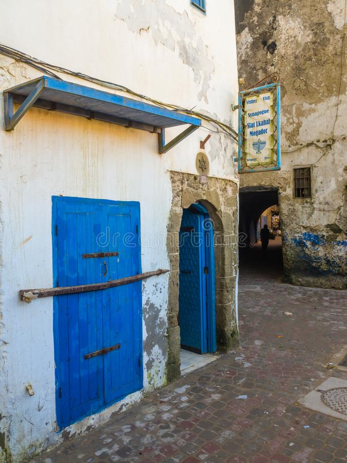 From the alleys of the medina in Essaouira. Synagogue Slat Lkahal in the alley of the medina in Essaouira, Morocco stock photo