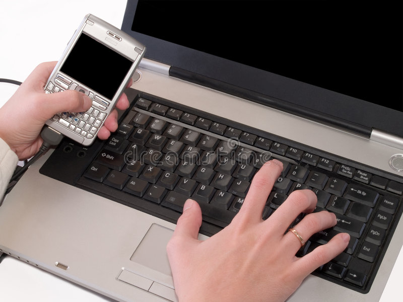 Synchronization of data between pda and laptop stock photography