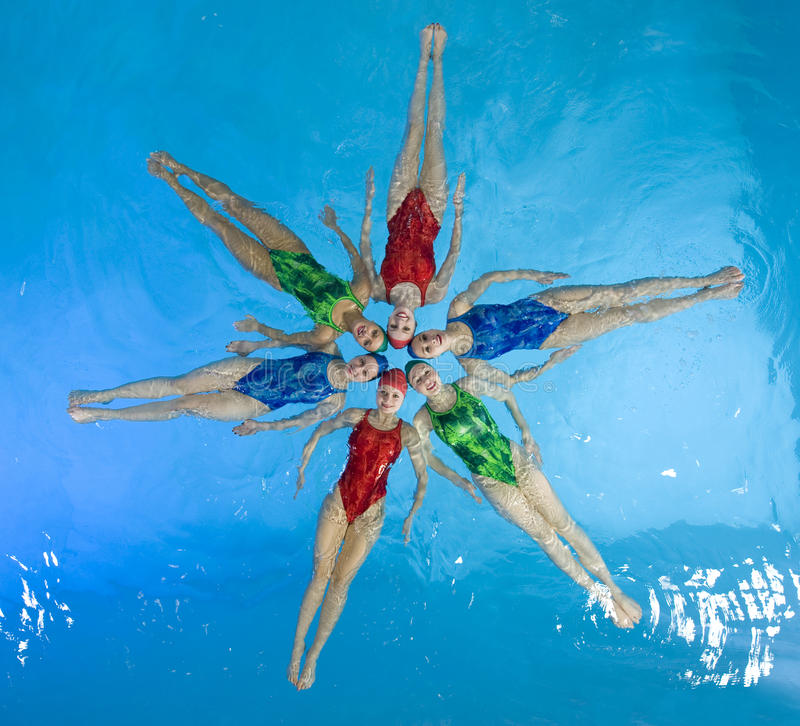 Synchronized swimmers. Hold pose for camera royalty free stock image