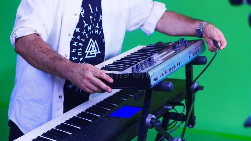 Synthesizer keyboard musical instrument art musician hands royalty free stock photography