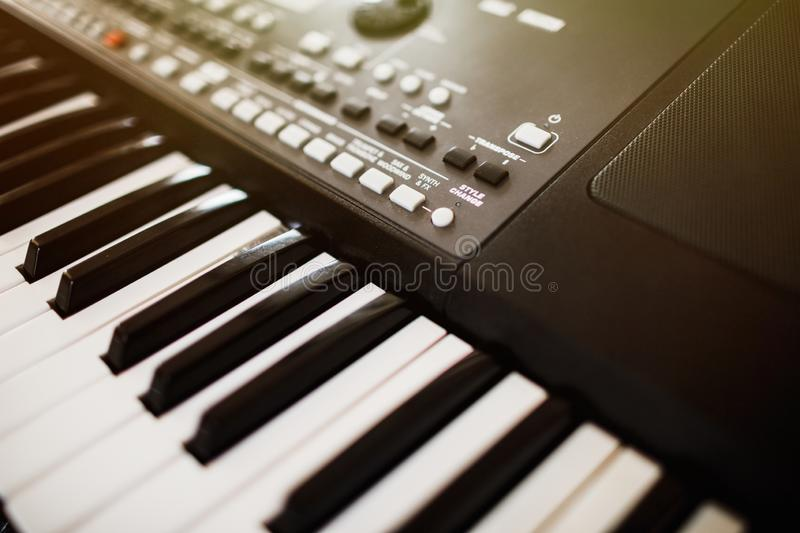 Synthesizer knobs. piano keys close-up. electronic musical instr stock photos