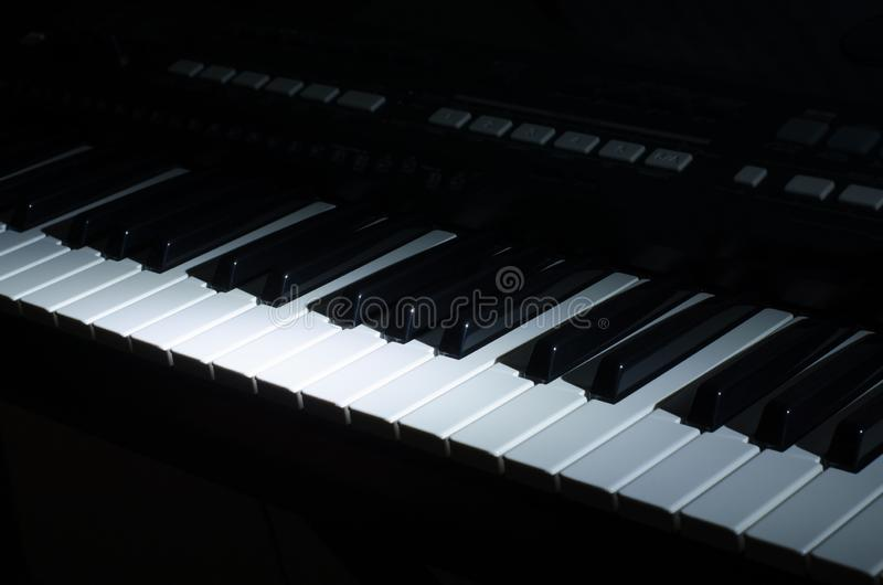 The synthesizer music in the dark stock images