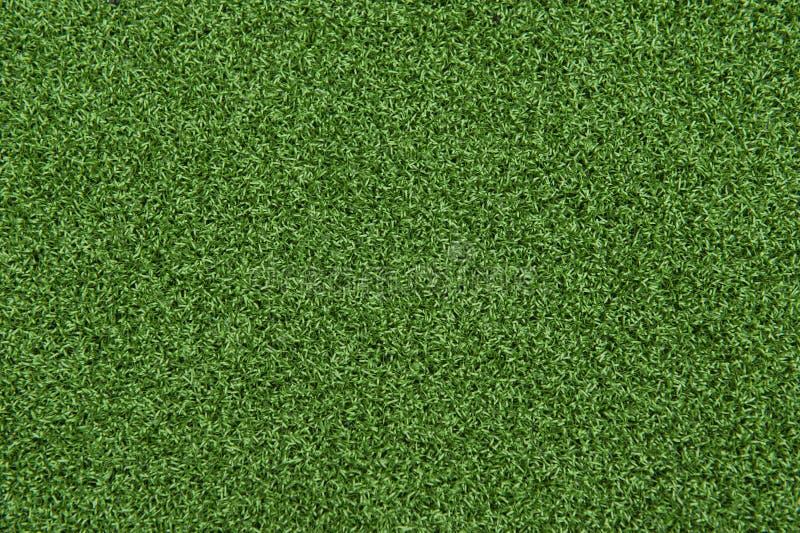 Synthetisch Gras of Kunstmatige Grasachtergrond stock afbeelding