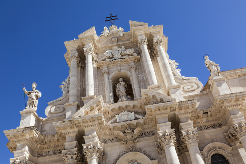Syracuse cathedral. Exterior of Syracuse cathedral sicily against blue sky stock photos