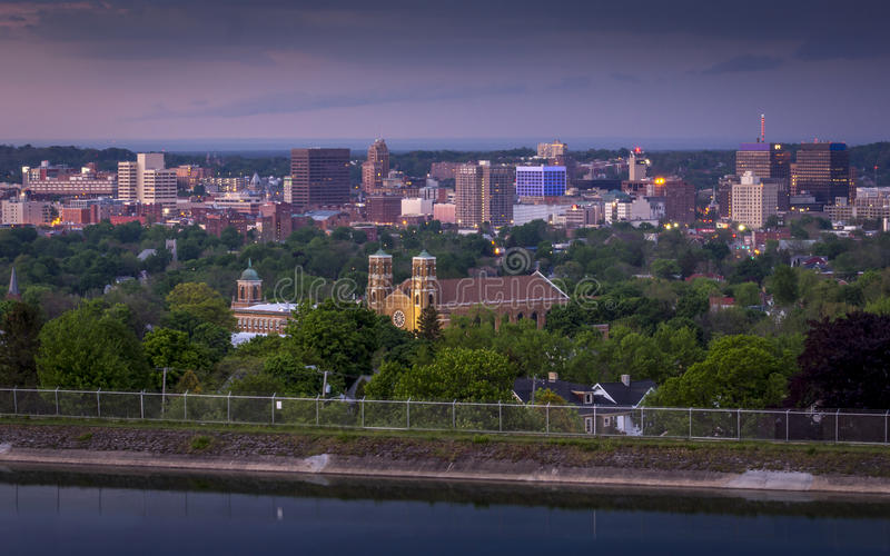 Syracuse New York Downtown. Onondaga Syracuse New York serene clouds sky upstate view skyline city city view downtown Mony Axa night blue hour most holy rosary royalty free stock images