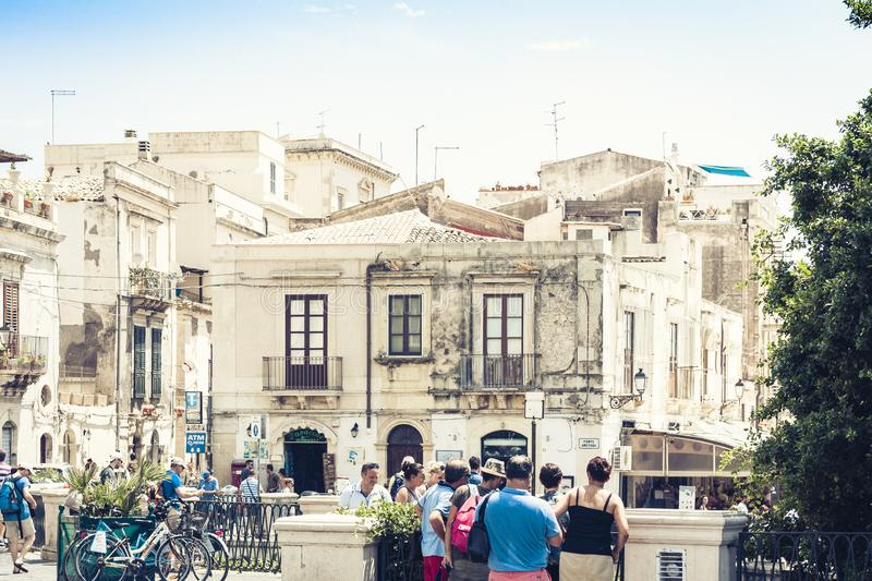 Syracuse, Sicily, Italy – august 12, 2018: people walk on the historical street of the Ortygia Ortigia island. People walk on the historical street of the stock photography