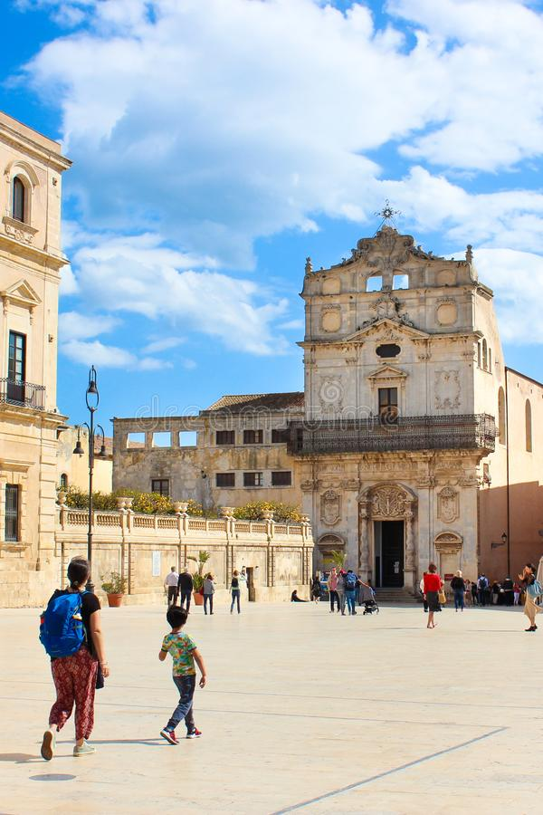 Syracuse, Sicily, Italy - Apr 10th 2019: Historical Piazza Duomo Square with beautiful Santa Lucia Church. Taken with tourists. On the main square. Tourist royalty free stock image