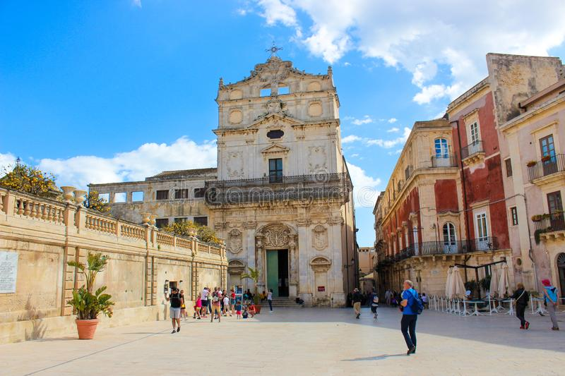 Syracuse, Sicily, Italy - Apr 10th 2019: People walking on the Piazza Duomo Square in front of impressive Santa Lucia Alla Badia. Church. Popular tourist royalty free stock images