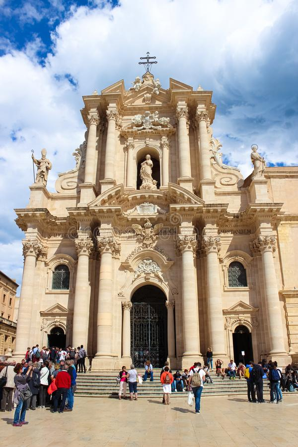 Syracuse, Sicily, Italy - Apr 10th 2019: Tourists in front of Syracuse Cathedral on Piazza Duomo Square. Popular landmark. And tourist attraction. Vertical royalty free stock images