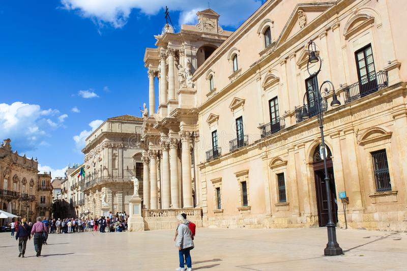 Syracuse, Sicily, Italy - Apr 10th 2019: Tourist on Piazza Duomo Square in Ortygia Island. The dominant of the historical center. Syracuse, Sicily, Italy - Apr royalty free stock photography