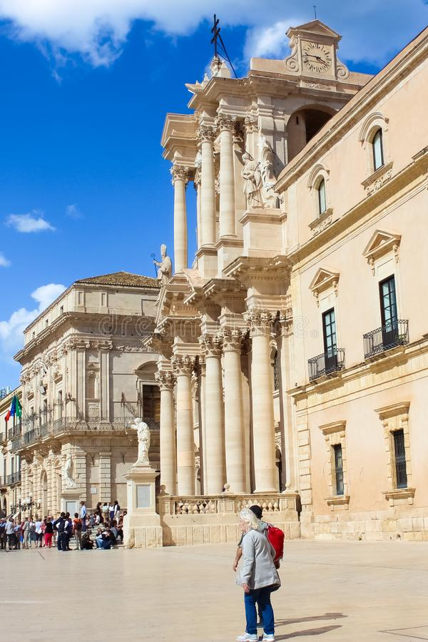 Syracuse, Sicily, Italy - Apr 10th 2019: Tourists on Piazza Duomo Square in Ortygia Island. Dominant of the historical center. Is Baroque Syracuse Cathedral stock photos