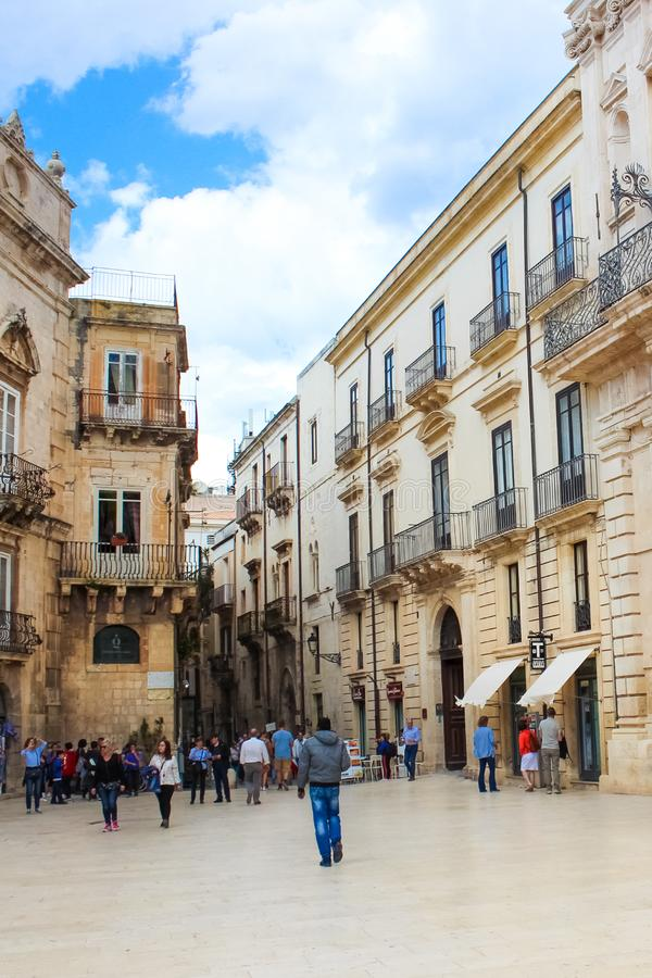 Syracuse, Sicily, Italy - Apr 10th 2019: Tourists walking on the Piazza Duomo Square in the old town. The historical center. Of the beautiful city is located on stock image