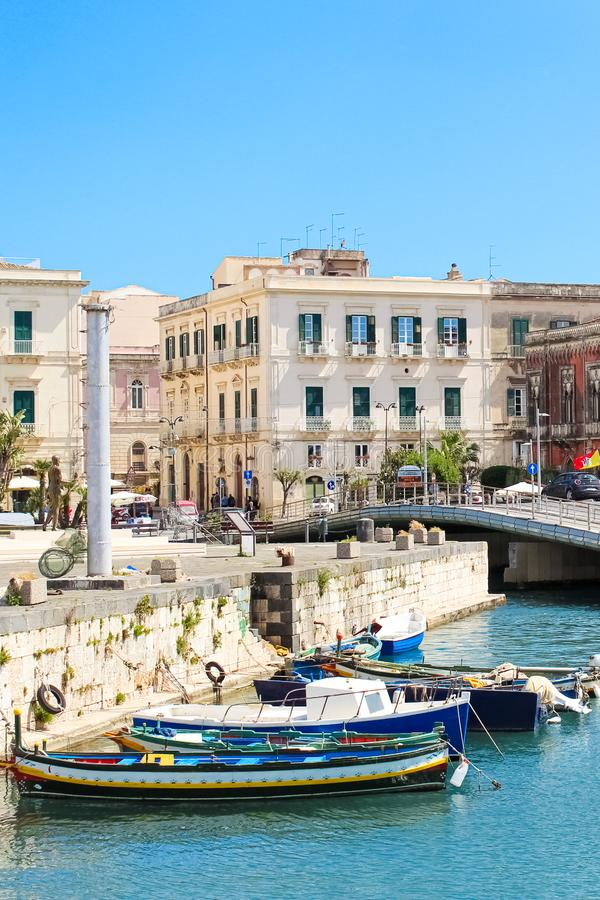 Syracuse, Sicily, Italy - Apr 10th 2019: View of small marina with boats between city Syracuse and famous Ortigia Island stock photos