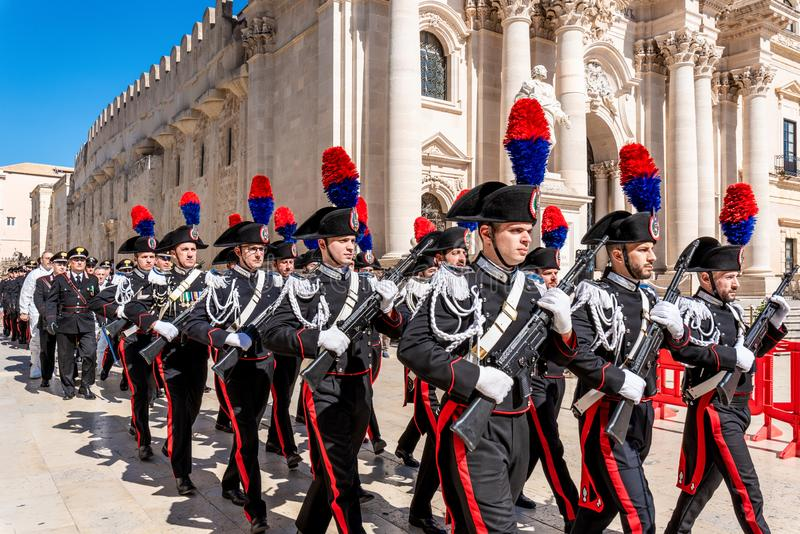 Syracuse Sicily/ Italy -June 05 2019: Parade of the carabinieri who wear the uniform and the historical hats with plume. Parade of the carabinieri who wear the stock photo