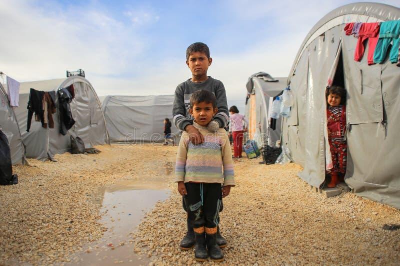 Syrië-oorlog-kind-slachtoffer-VLUCHTELING royalty-vrije stock afbeeldingen