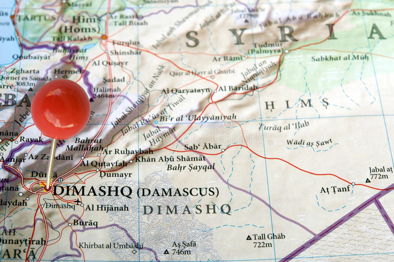 syria on a map with a red pin in damascus