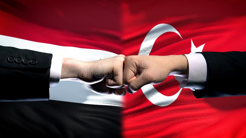 Syria vs Turkey conflict, international relations, fists on flag background. Stock photo stock images