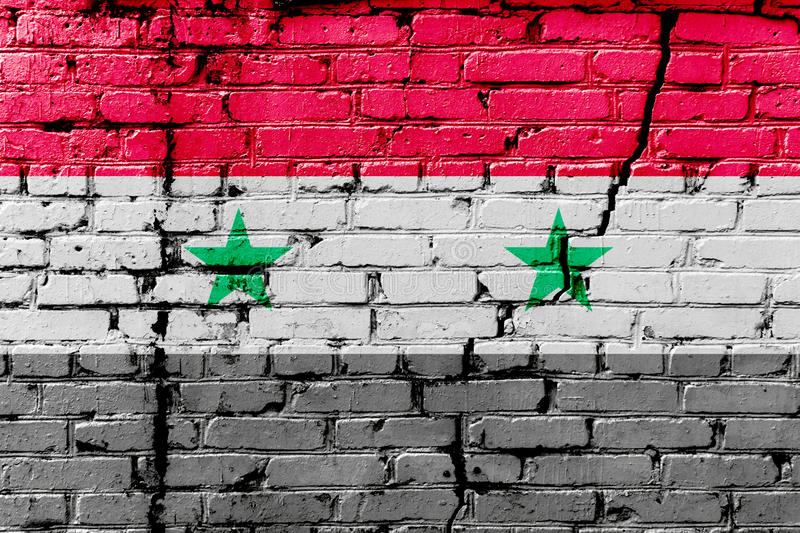 Syrian flag painted on a brick wall. Flag of Syria. Textured abstract background royalty free stock images