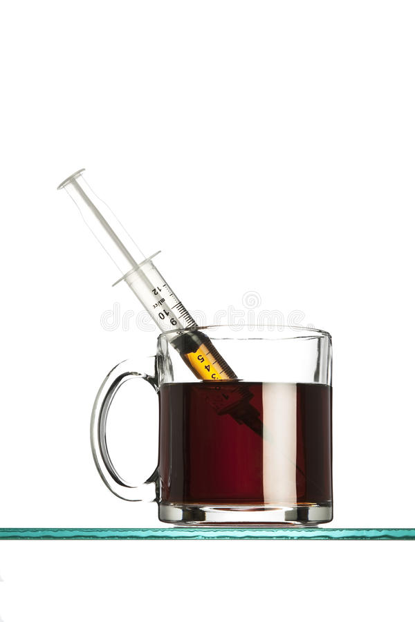 Download Syringe In A Cup Of Coffee Royalty Free Stock Photos - Image: 17032008