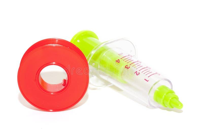 Syringe and gauze stock photos