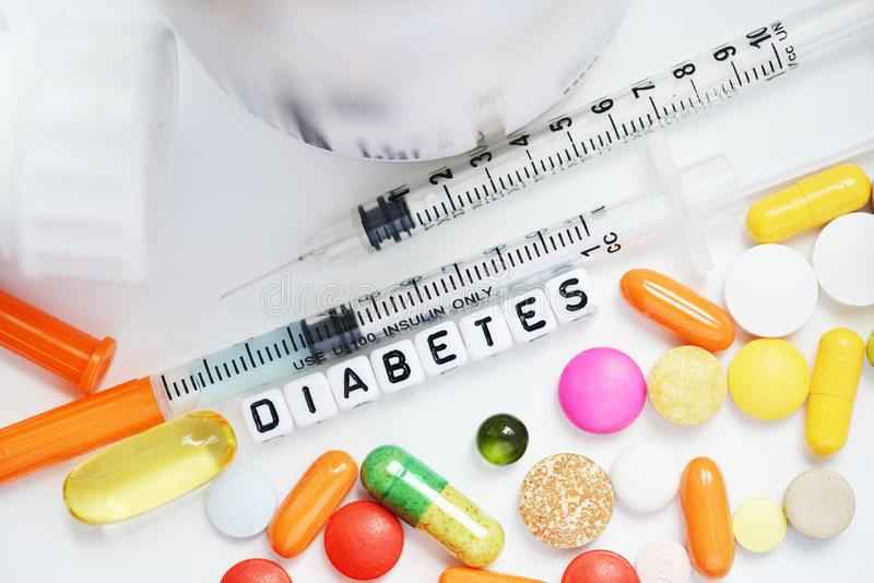 Syringe and medical drugs for diabetes, metabolic disease treatment stock photo