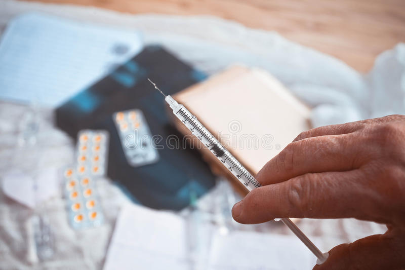 Syringe, medical injection in hand, palm or fingers. stock photo