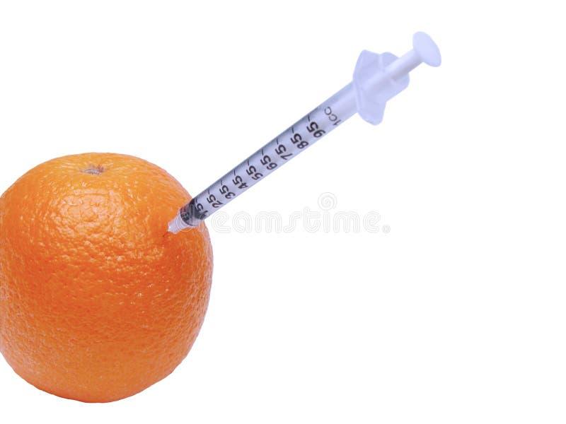 Syringe in orange stock photo