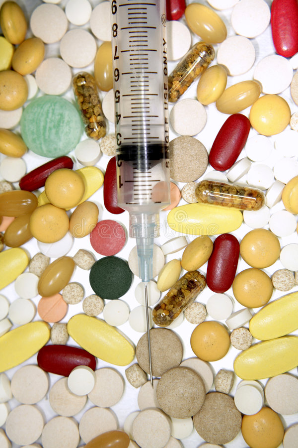syringe and pills royalty free stock photo