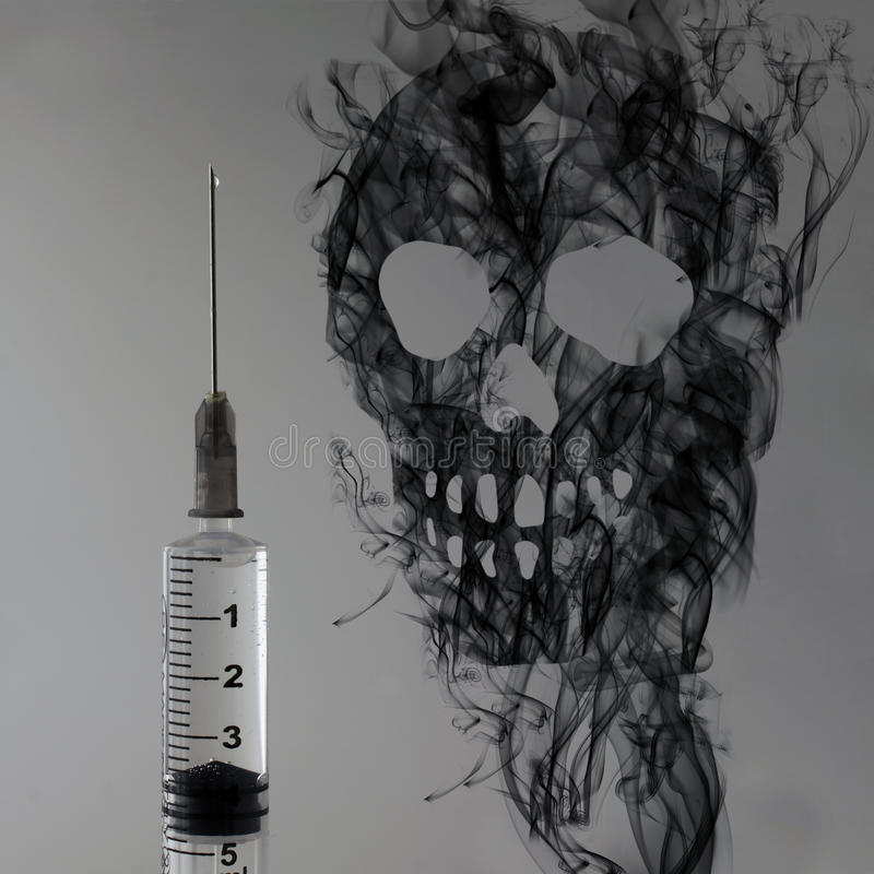 Syringe And Skull Stock Images