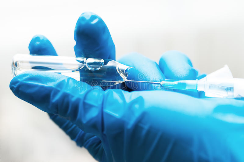 Syringe with vaccine stock images