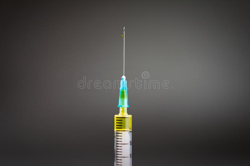 Syringe with yellow drug stock photo  Image of hand - 147128066